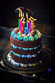 Chocolate birthday cake with blue cream and eastern eggs