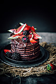 Banana chocolate pancakes with figs and berries