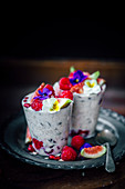 Chia seeds, figs and raspberries smoothie with flowers