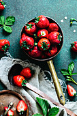 Still life of strawberries in a copper pan