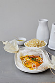 Cinnamon-flavored butternut squash,onion and chive papillote,cracked wheat