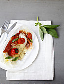 Chicken fillet with mozzarella,Parma ham,cherry tomato and basil papillote