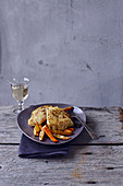 Pan-fried cod with herbs,tender yellow and orange carrots