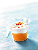 Stewed apricots with yoghurt and thinly sliced grilled almonds