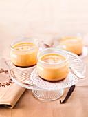 Small pots of vanilla and caramel custards