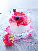Glass of whipped fromage blanc, Biscuits roses de Reims crumbs and mixed summer berries