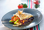 Sea bream fillet with garlic and three colored peppers