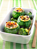 Round courgettes stuffed with Thai rice,peanuts and coriander