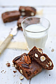 Chocolate,almond,pecan and hazelnut brownies and a glass of milk