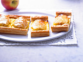 Apple and confectionner's custard tarts