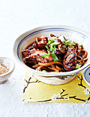 Udon noodles with caramelized chicken