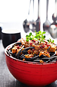 Squid ink spaghetti with red pesto