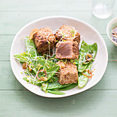 Diced tuna coated in sesame seeds, sweet pea salad with alfafa and shallot vinaigrette