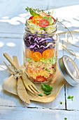 Mixed semolina savoury salad in a jar