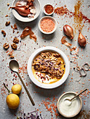 Orange lentil and sweet potato soup with walnuts and crisp shallots