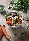 Brown rice,sweet potato and black bean burrito bowl