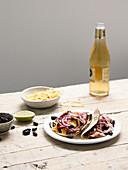 Wheat tortillas garnished with mushrooms, black beans, red onions and Mimolette cheese