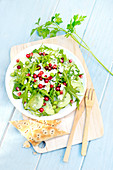 Rocket lettuce,cucumber,spinach,pea,feta,redcurrant and pomegranate seed salad