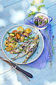 Sardines grilled with fresh herbs,sauteed potatoes and red onions