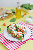 Baby spinach,feta and cherry tomato open-sandwiches