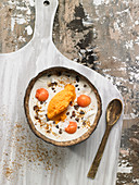 Yoghurt With Cashews,Papaya,Coconut,Chocolate Flakes And Agava Syrup