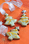 Spicy Shortbread Christmas Trees With Icing And Orange Rinds