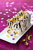 Vanilla and confit citrus ice cream log cake