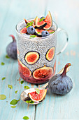 Glass of chia seeds with figs and marjoram
