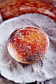 Once cooked ,fill the Berlin donut with jam and coat with castor sugar