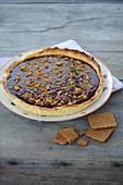 Chocolate and crushed speculoos biscuit tart