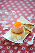 Soft-boiled egg with salmon roe placed on a Bouchée à la reine