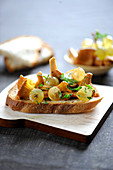 Chanterelles and white grapes on toast