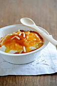 Faisselle with stewed peaches,express caramel and pine nuts