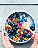 Porridge with blueberries and blackberries