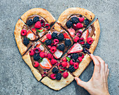 Chocolate and summer fruit heart-shaped pizza
