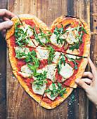 Tomato,mozzarella and mushroom heart-shaped pizza