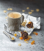Mug of hot chocolate and chocolate,dried apricot,almond and fig cereal bars
