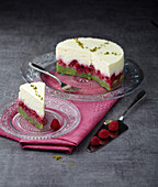 White chocolate,raspberry and pistachio mousse cake