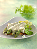 Toasted sandwich bread garnished with asparagus,creamy tofu sauce with tamarisk and herbs