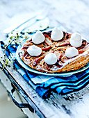 Lemony almond cream and peach flaky pastry tart with whipped cream