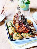 Rack of pork with herbs,onions and Hasselback potatoes