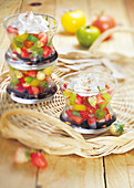 Multicolored tomato and two type of strawberry fruit salad