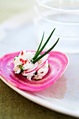Chioggia beetroot,goat's cheese,chive and pink peppercorn canapé