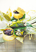 Bass fillets cooked in banana leaves,steamed black rice