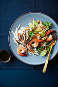 Jumbo shrimps with rice noodles,spring leeks,black sesame seeds and coriander