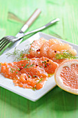 Salmon carpaccio with grapefruit and spices