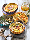 Vegetable spaghettis and parmesan cream quiches
