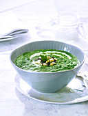 Spinach and parsley soup with black olives and button mushrooms