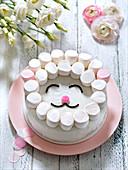 Marshmallow-Osterkuchen in Lammgesicht