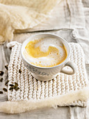 Cream of pumpkin soup with foamy milk topping